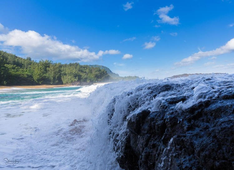 Massive waves crash over the rocks on Lumaha'i beach in Kauai