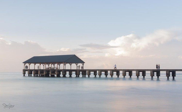 Long exposure blurred motion image of dawn over Hanalei pier in Kauai