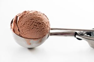 42309284 - fresh chocolate ice cream scoop close up.