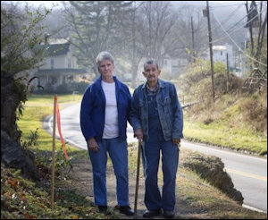 Fern and Earl Echols stand near a pipeline marker on their property in Giles County. Photo credit: Roanoke Times