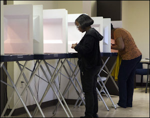 Voting booths in Portsmouth. Photo credit: Virginian-Pilot