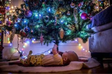 baby under a Christmas tree