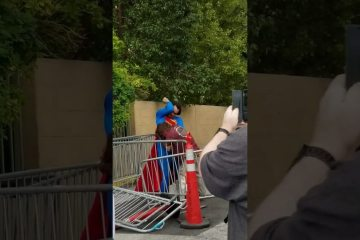 Superman beats up a bum on Las Vegas Strip