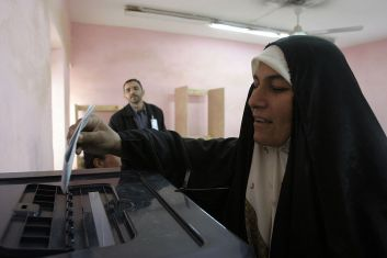 Iraqi woman voting in 2005.