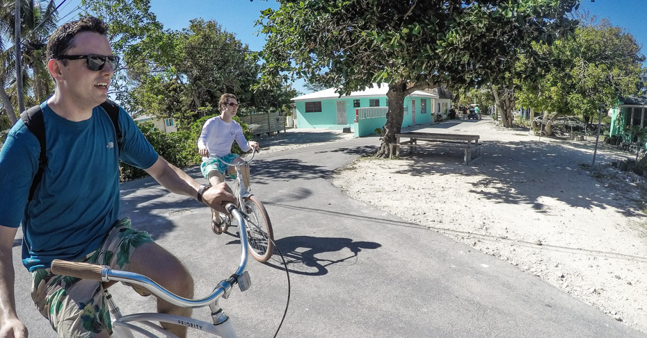 Exploring Staniel Cay on bikes. It's easy to cycle around as the Staniel Cay village is very small. Cycle to the docks, beach, airport, shops and the Staniel Cay Yacht Club. Day trips to Bahamas with Bahamas Air Tours.