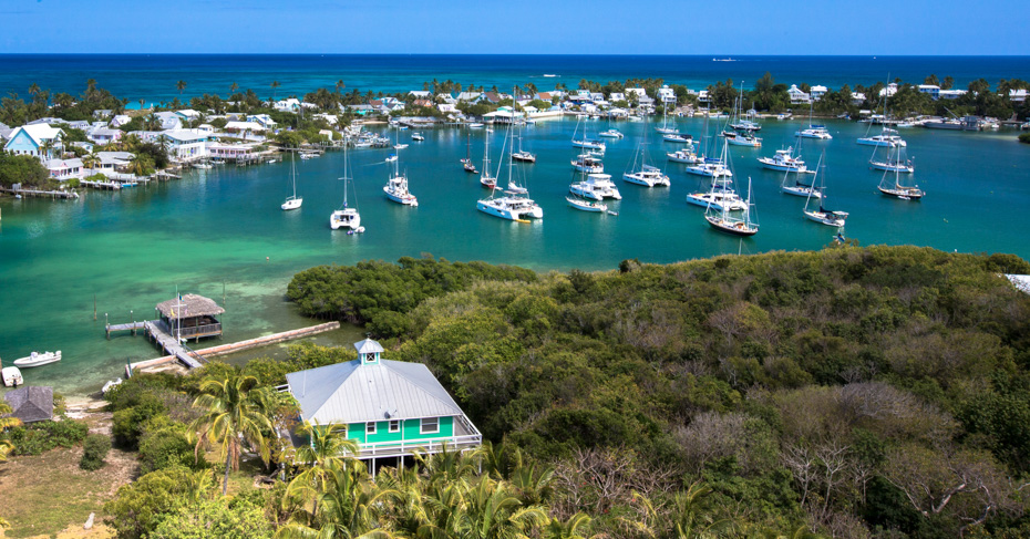 Hope Town lighthouse views across elbow cay Bahamas. Visit the Abaco Bahamas on a Day trip to Bahamas with Bahamas Air Tours.