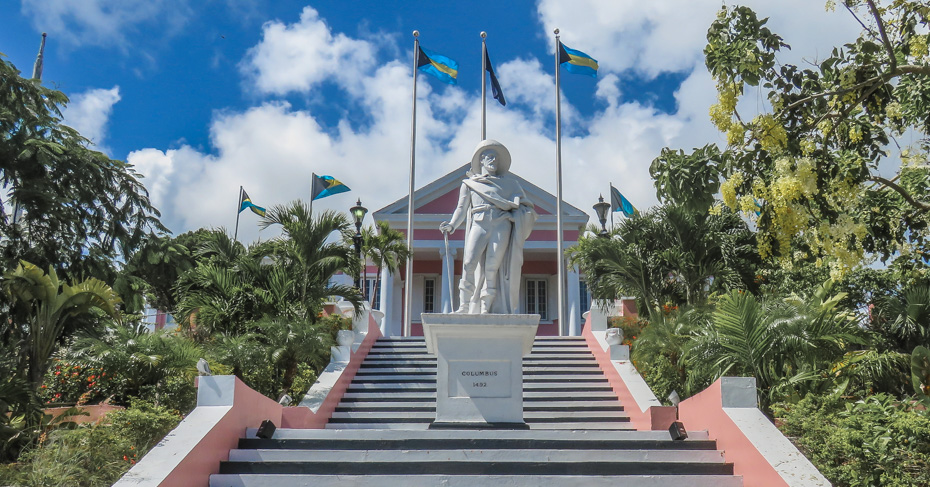 Steps lead up to Government House Nassau Old Town, top things to do in Nassau Bahamas, to the statue of Christopher Columbus. Take a Nassau walking tour on your Nassau city tour with Bahamas Air Tours.