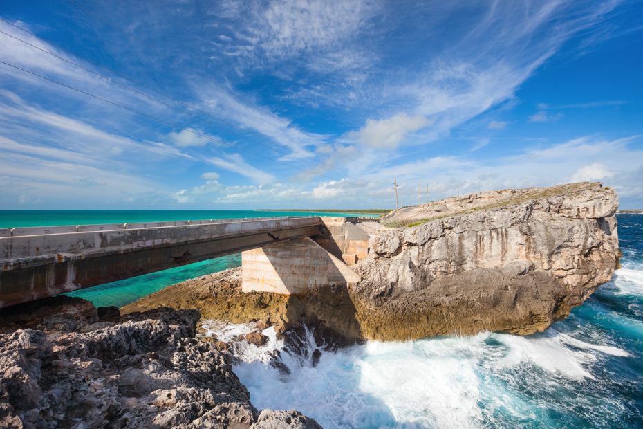 Glass window bridge on Eleuthera Bahamas Bahamas where Caribbean sea meets Atlantic ocean. Flights to North Eleuthera with Bahamas Air Tours from Florida.