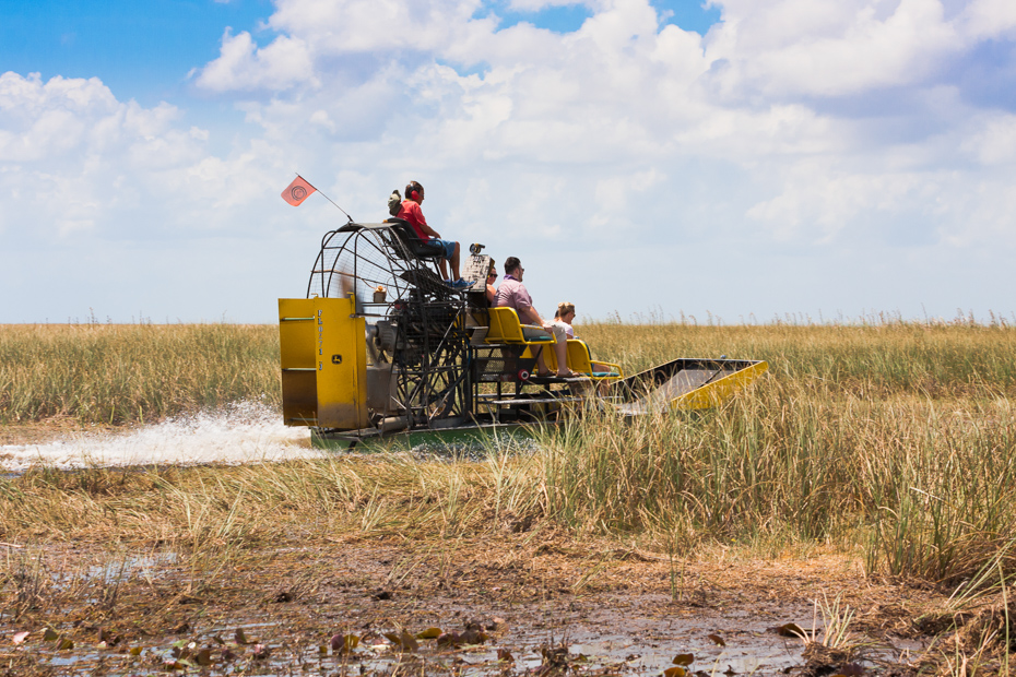 Everglades National Park, Florida. June 07, 2015. Group of tourists riding an airboat in Everglades National Park. Best Things to do in Florida include Airboat Rides Florida attractions as well as island getaways. Bahamas Air Tours brings you What to Do in Florida as well as a few Miami Florida Attractions like a Bahamas Day Trip for your next Florida Vacation.