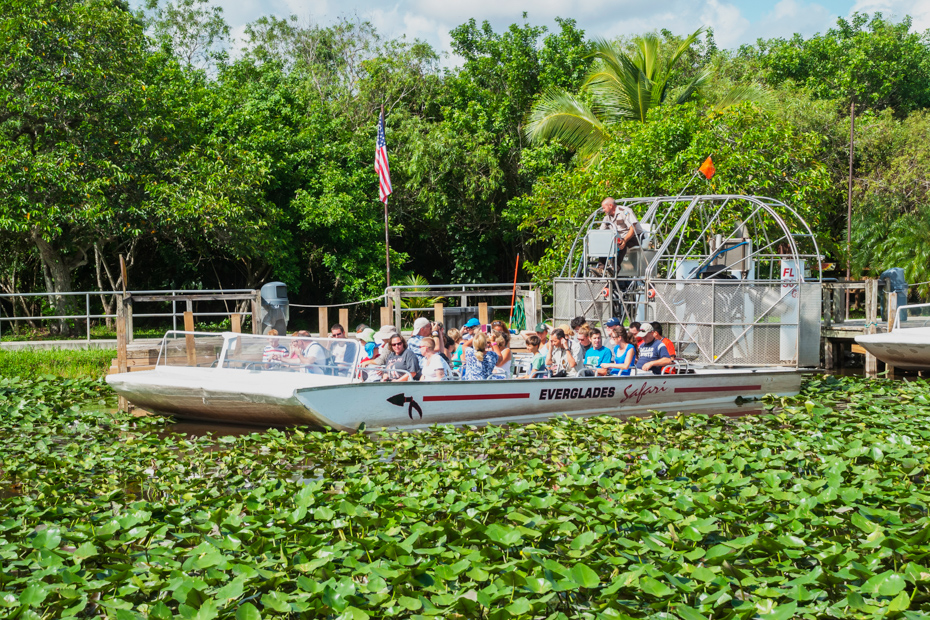 Airboat full of tourists leaves for the tour in the Everlades National Park in Florida best things to do in Florida.