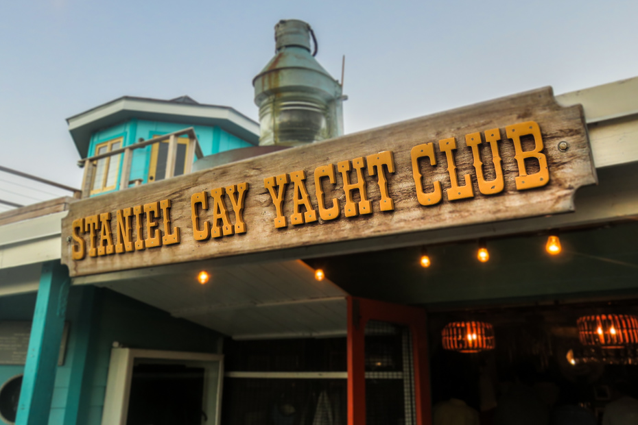 The original Staniel Cay Yacht Club sign at the Bar Entrance at Staniel Cay in the Exumas Bahamas.