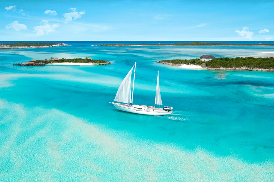 Enjoy the fresh sea breeze on a sail boat! Aerial view of a day cruise to Bahamas to see the Bahamas swimming pigs.