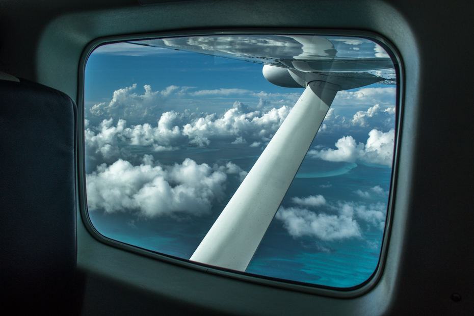 Looking out of the window of a private Bahamas air charter. Taking the ferry Bahamas Miami day trip will get you there twice as slow.