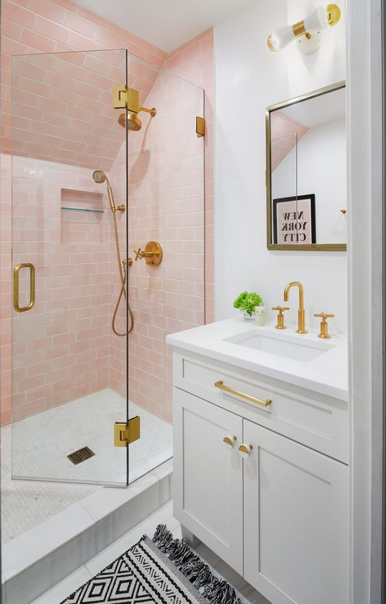 blush and gold tiled shower in bathroom
