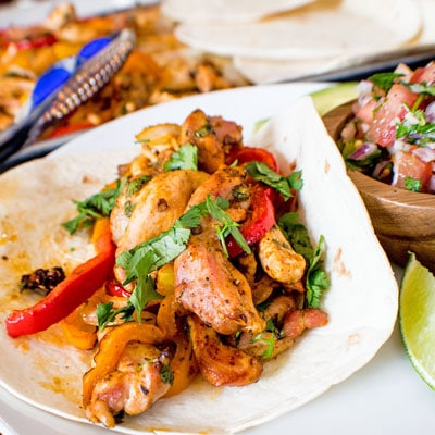 Sheet Pan Chicken Fajitas are a fast and easy one dish dinner, perfect for busy families!