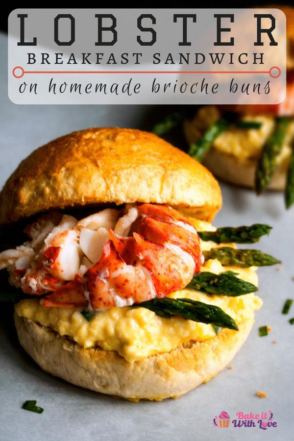An amazing Lobster Breakfast Sandwich piled high with creamy scrambled eggs, asparagus spears and lobster on a fresh brioche sandwich bun!