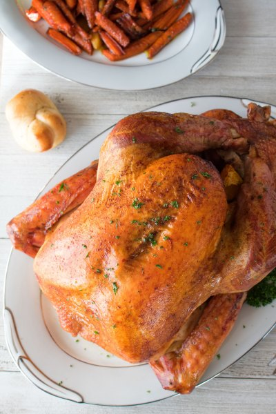 Perfectly roasted turkey is a beautiful centerpiece on the Thanksgiving table.