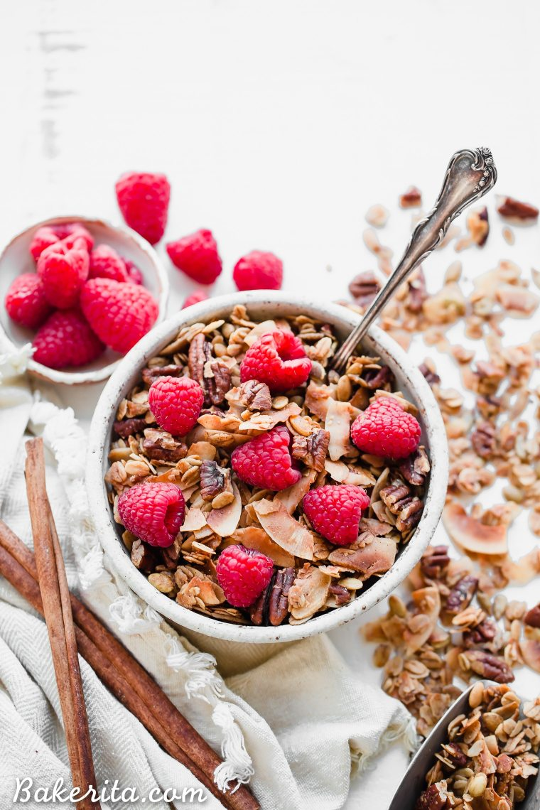 This Coconut Pecan Granola is a flavorful, crunchy, and just lightly sweetened with maple syrup. This gluten-free, refined sugar-free, and vegan granola is perfect for stirring into your yogurt, serving with milk or eating on its own as a snack.