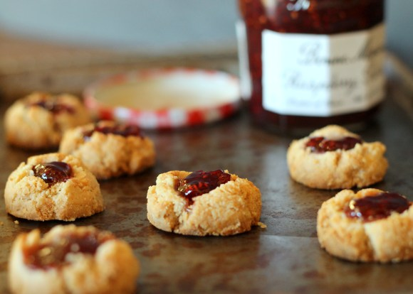 These Jam Thumbprint Cookies are gluten-free, vegan, refined sugar-free and can be made paleo. This simple recipe has only four ingredients!