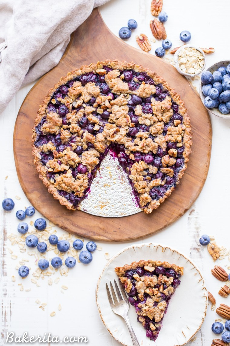 This Blueberry Crisp Tart with Oatmeal Crust comes together quickly and easily, and it's the perfect use for your fresh blueberries! This simple recipe is gluten-free & vegan.