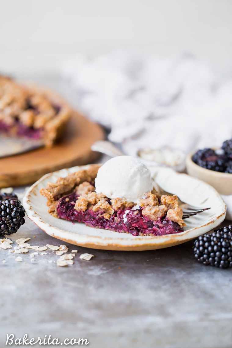 This quick and easy Blackberry Crisp Tart has an oatmeal crust, a layer of quick blackberry chia jam, and fresh blackberries! It's perfect with vanilla ice cream. This simple recipe is gluten-free, refined sugar-free and vegan.