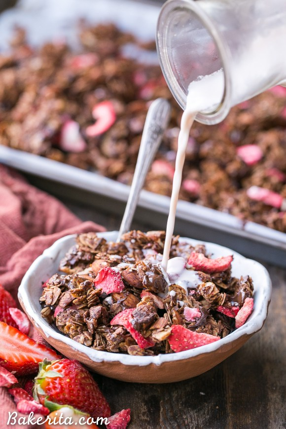 Chocolate Strawberry Granola is healthy enough to eat for breakfast, but it's so delicious you'll want to have it for dessert too! This simple and easy granola recipe is gluten-free, vegan, and refined sugar free, and it's loaded with chocolate & strawberry flavor.