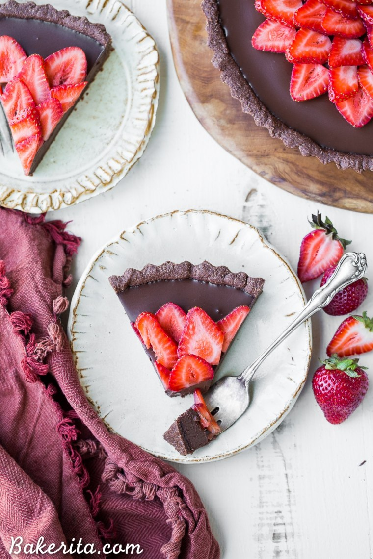 This Strawberry Chocolate Tart is filled with vegan chocolate ganache andtopped with fresh strawberries, all in a chocolate crust. Slice into this easy and delicious gluten-free, Paleo, and vegan dessert.