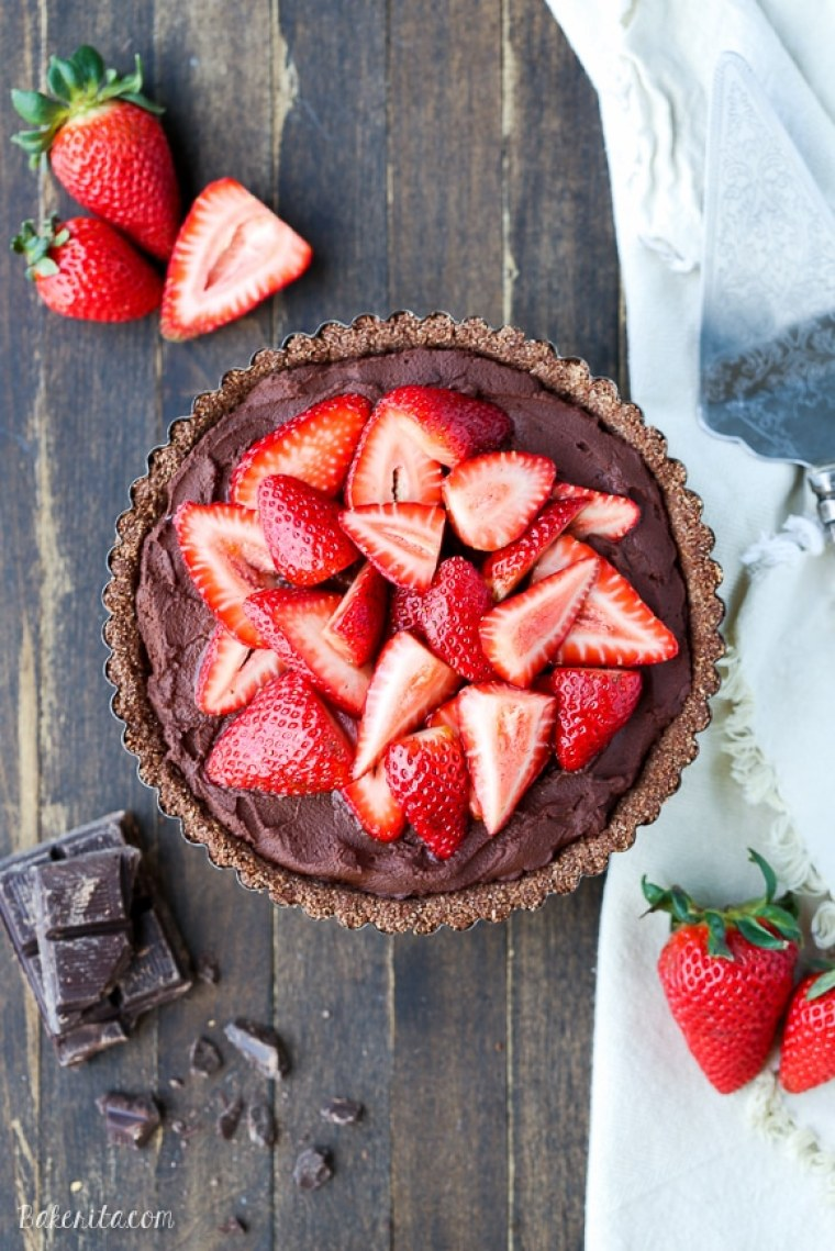 This Strawberry Chocolate Tart is filled with whipped vegan chocolate ganache and topped with fresh strawberries, all piled in a chocolate crust. Slice into this easy and delicious gluten-free, Paleo, and vegan dessert.