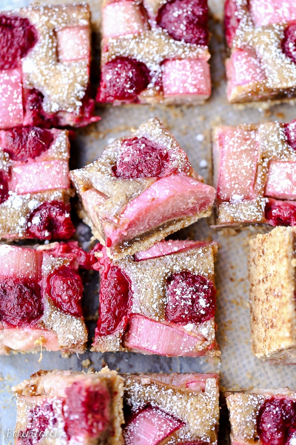 These Raspberry Rhubarb Almond Bars have an crisp almond flour crust topped with soft almond frangipane, fresh raspberries, and tart rhubarb. This recipe is Paleo, gluten free + refined sugar free.