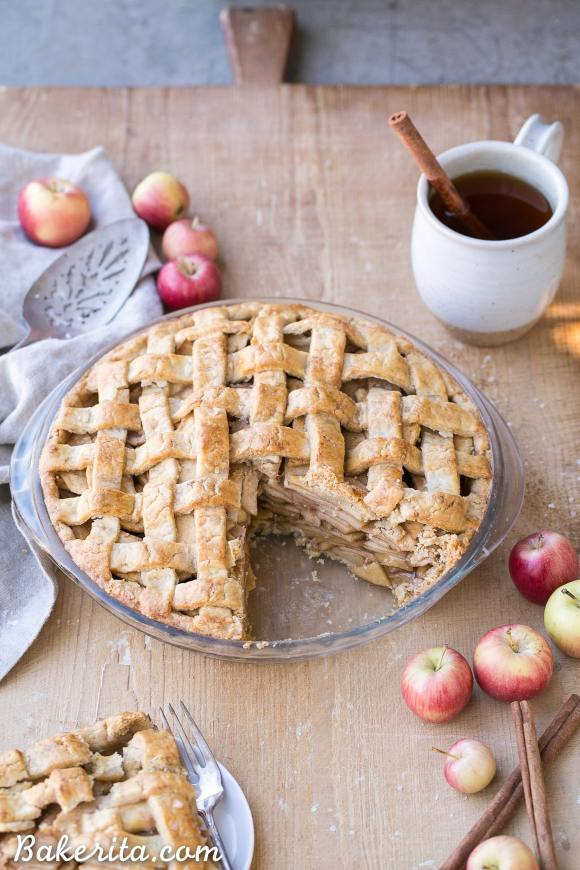 This Paleo Apple Pie has a flaky gluten-free lattice crust with a delicious spiced apple filling! Your holiday dessert table isn't complete without apple pie, and this healthier refined sugar free recipe will satisfy any apple pie lover.