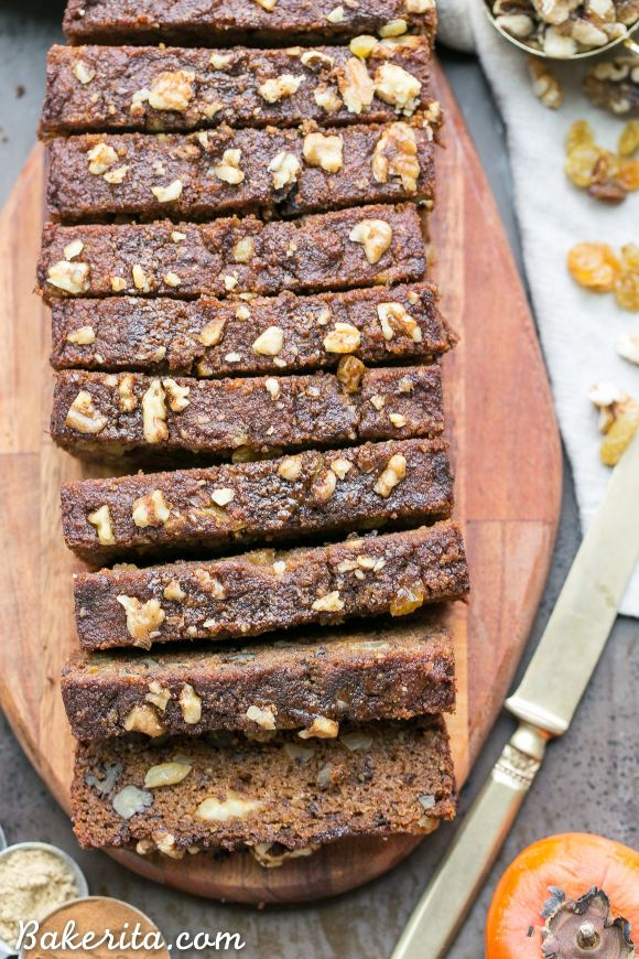This Paleo Persimmon Bread is a healthy treat that uses pureed Fuyu persimmons for flavor and moisture, and is loaded with toasted walnuts & golden raisins! This gluten-free persimmon bread is spiced with cinnamon, ginger and allspice and makes a perfect breakfast or snack.