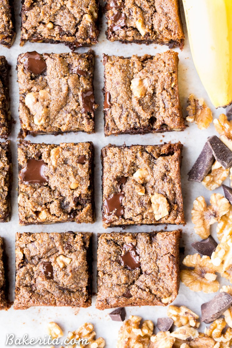 These Chocolate Chunk Banana Nut Blondies are a super chewy blondie, flavored with fresh bananas and studded with crunchy walnuts and dark chocolate chunks. You'd never guess that they're gluten-free, paleo and vegan.