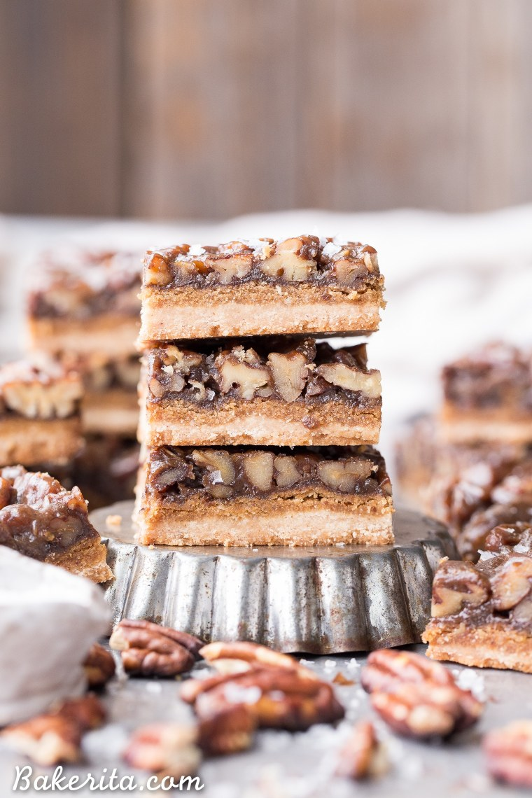 These Pecan Pie Bars are thick and caramelly, with a crispy coconut flour shortbread crust and a gooey pecan pie filling on top. These gluten-free, paleo, and vegan bars will be the star of your dessert spread!