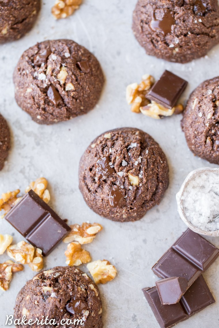 These Dark Chocolate Chunk Cookies are incredibly rich and dark, with melty chocolate chunks and toasted walnuts for crunch. These chewy, fudgy dark chocolate chip cookies are gluten-free, paleo, and vegan, and perfect for the chocolate lover in your life.