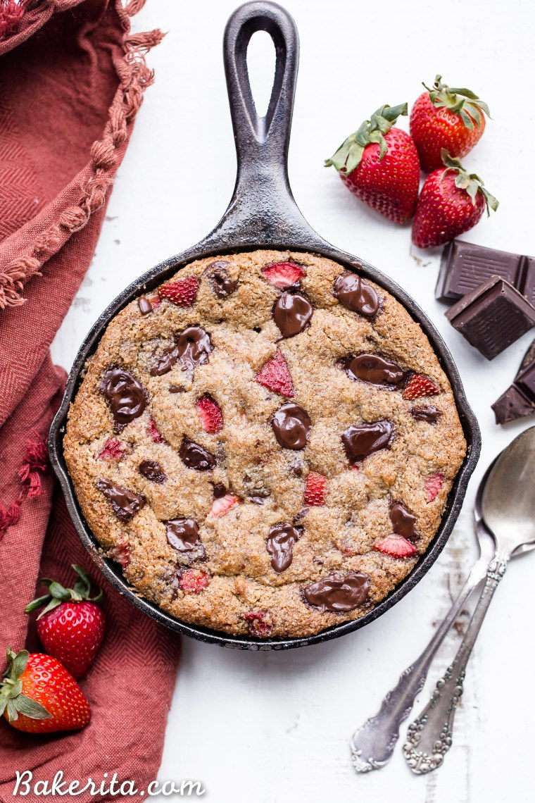 This Strawberry Chocolate Chunk Skillet Cookie is gooey in the middle, with crispy edges and all the flavors you love in a chocolate covered strawberry! This gluten-free, paleo and vegan skillet cookie will satisfy all your cravings - the fresh strawberries are the perfect fruity addition to this rich, chocolatey treat!