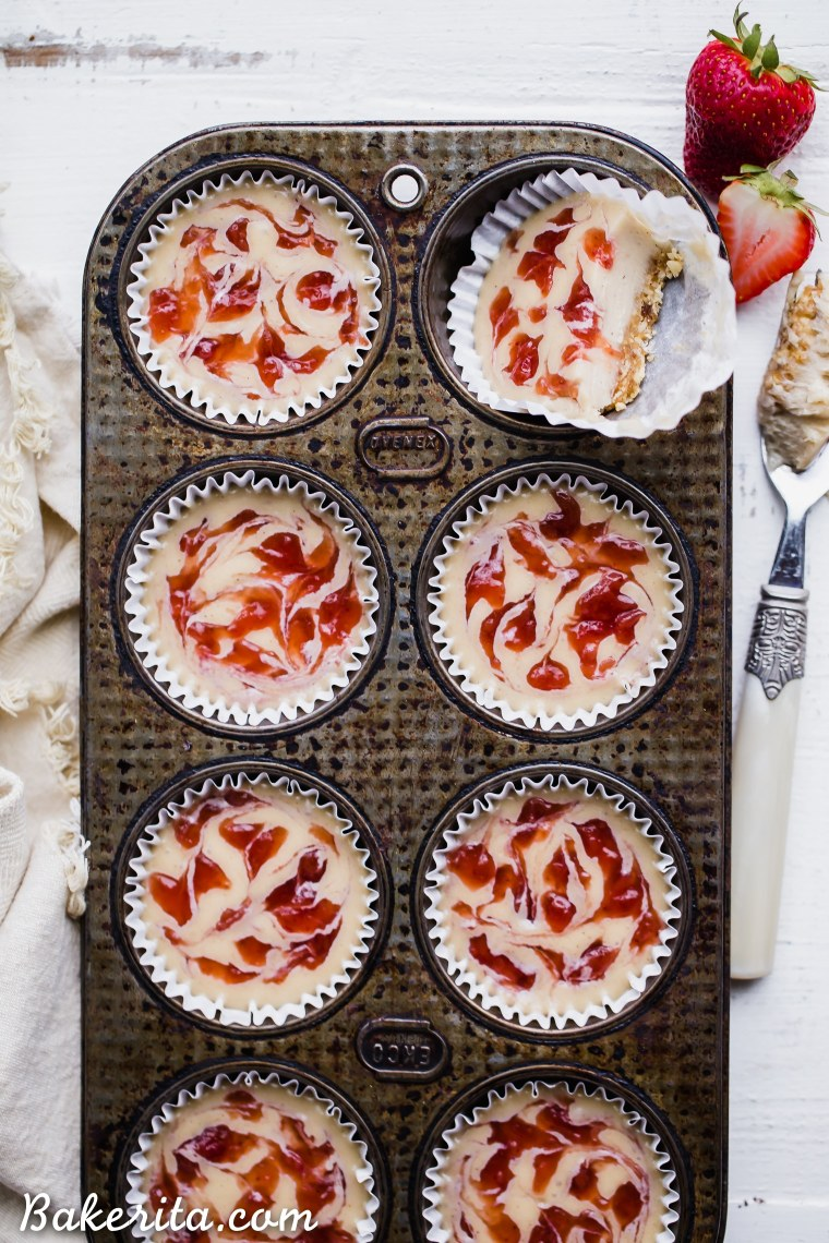 These No Bake Cashew Butter & Jelly Cheesecakes are sweet individual desserts that are lusciously creamy, simple to make, and swirled with strawberry jam. You can customize them withyour favorite nut butter and jelly to make them your own! They're gluten-free, paleo and vegan.