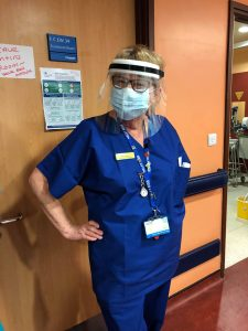Nurse with clear visor PPE