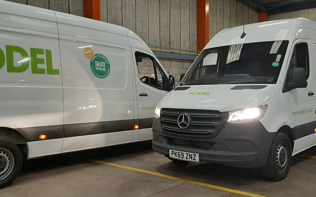 Yodel vans with Salute the NHS stickers