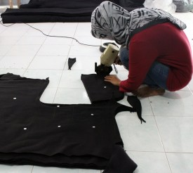 Cutting Fabric by Baki Clothing Company