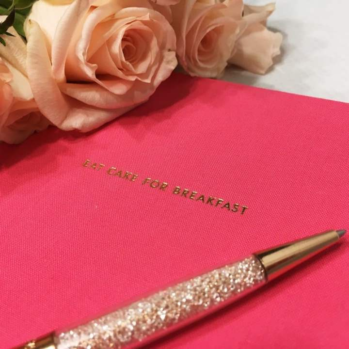 Pink notebook with a pan and roses