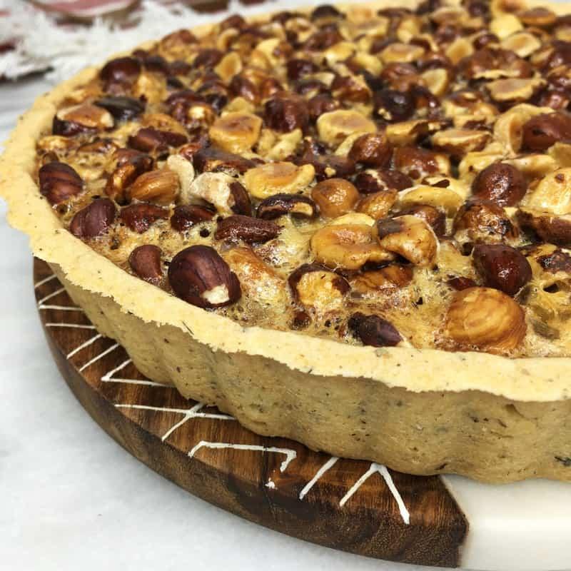 Honey Hazelnut pie served on marble board: Oblique vuew
