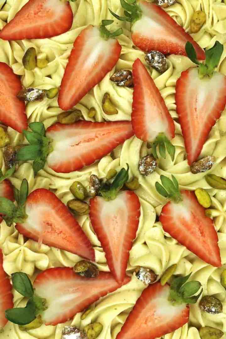 Sable Breton with the mousseline cream, strawberries, pistachios on top: close up, overhead closeup view