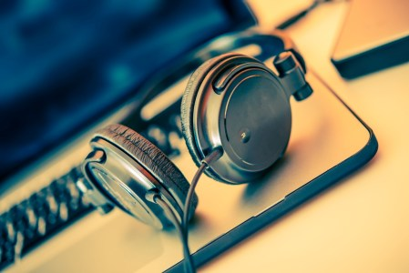 Headphones on Laptop Computer. Online Music Listening. Music Concept.