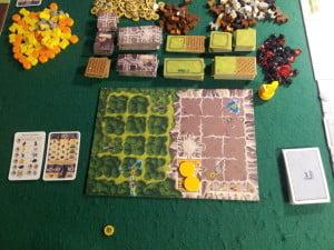 Ecco la board dove sorgeranno i nostri possedimenti: ce ne sono sei, una per giocatore. I tondini gialli sono i nani! Li chiameremo Tommy e Gina.