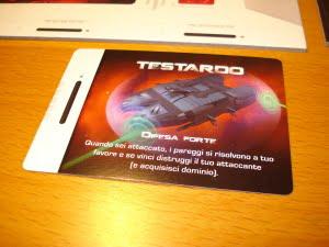 Sceglie di prendere la carta Testardo, che gli darà un certo vantaggio in combattimento.