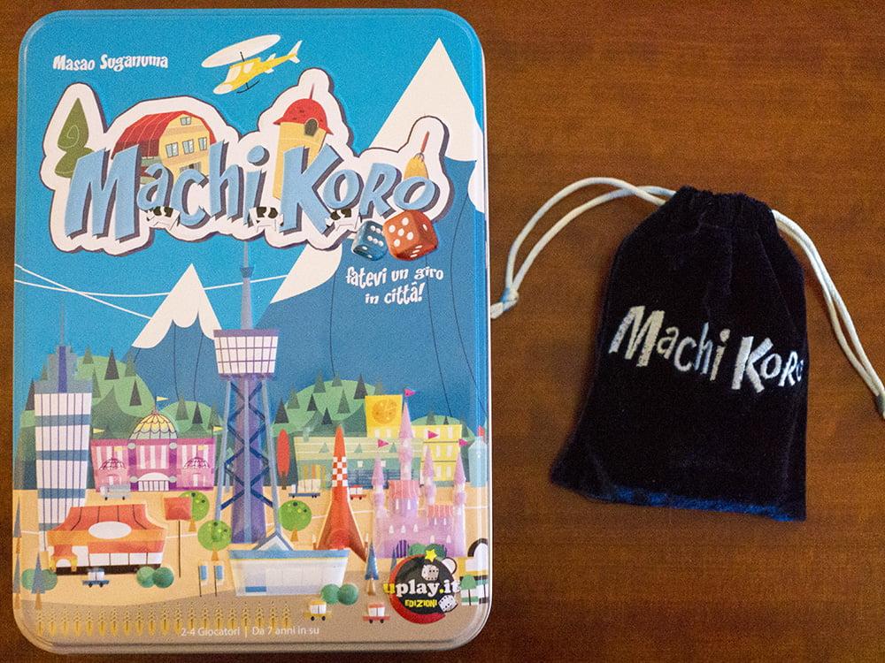 Le splendide confezioni di Machi Koro e dell'espansione Machi Koro Plus.