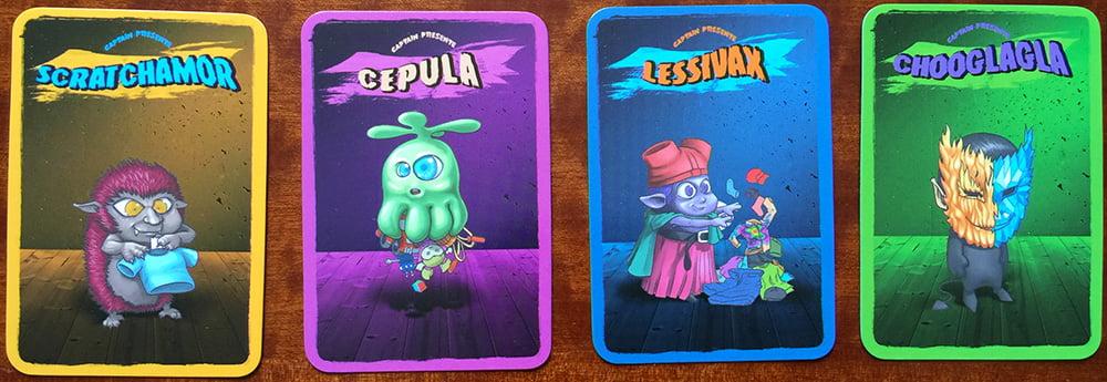 4 esempi di carte mostro di colore diverso: i giocatori dovranno ricordarsele per poi abbinare correttamente le creature raccolte con le relative gabbie colorate.