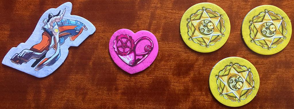 I 3 diversi tipi di token presenti nel gioco: da sinistra, il segnalino fuga, quello cuore e le tre stelle dello sceriffo.
