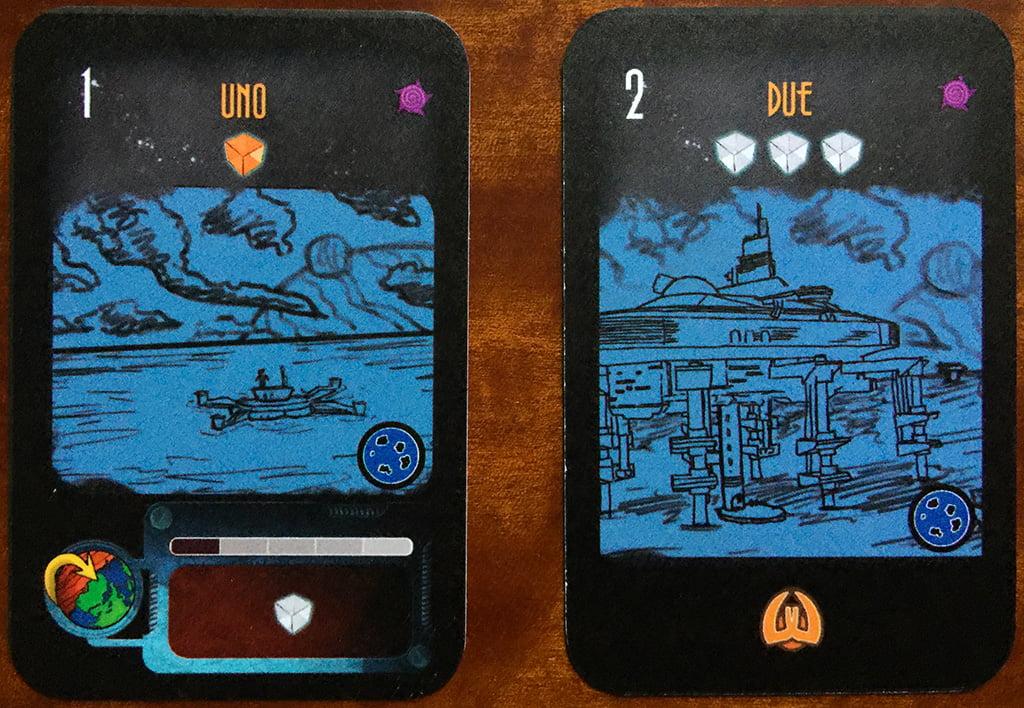 Due esempi di pianeti simili e appartenenti alla stessa tipologia (sfondo blu): il numero 1 è dal lato base e produce 1 cubo (in questo caso arancione);