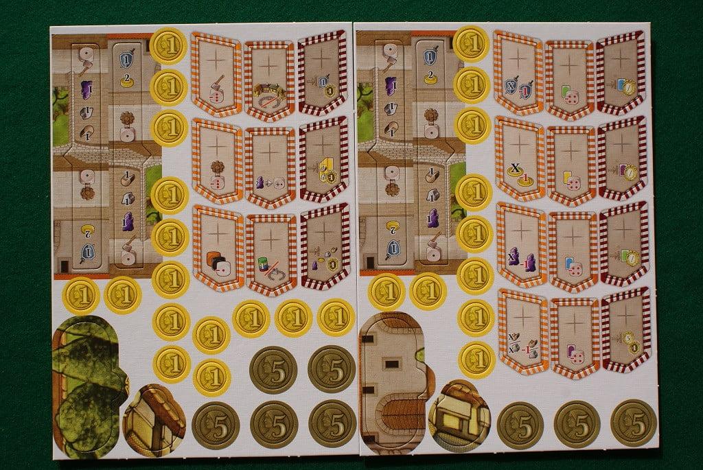 """Le tessere e le monete da sfustellare: da notare le quattro tessere ovali e tonde in basso a sinistra di ogni cartonato: esse servono a """"tappare"""" alcuni spazi azione quando si gioca in 3 o in 2. In alto a sinistra i listelli con le risorse standard"""
